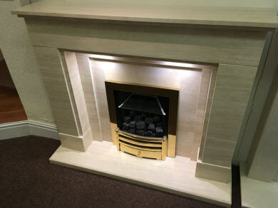 Polished travertine fireplace with lights